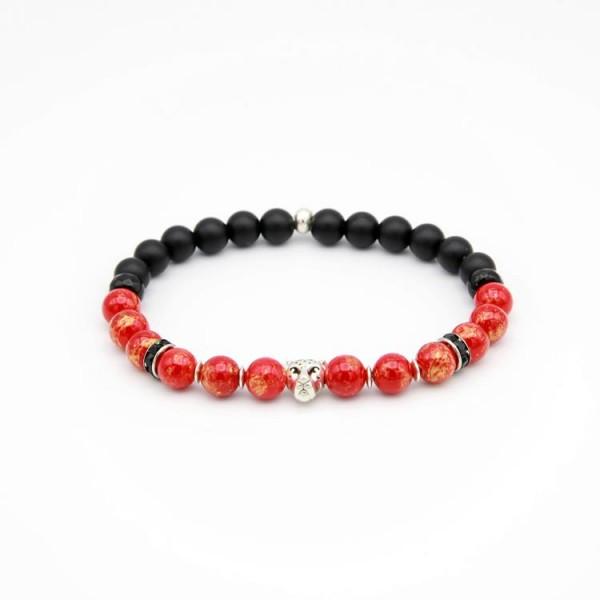 Armband mit mattschwarzen, schwarz facettierten und rot-goldenen Jade Perlen.